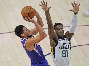 Utah Jazz guard Miye Oni (81) defends against Phoenix Suns guard Devin Booker, left, during the second half of an NBA preseason basketball game, Monday, Dec. 14, 2020, in Salt Lake City. (AP Photo/Rick Bowmer)