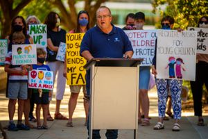 (Trent Nelson  |  The Salt Lake Tribune) Brad Asay, president of American Federation of Teachers-Utah, reacts to the county's vote against a mask mandate in schools on Thursday, Aug. 12, 2021.