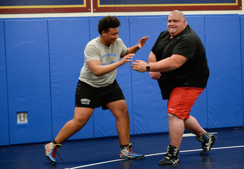 (Francisco Kjolseth | The Salt Lake Tribune) Traycee Norman, 16, jokes around with Olympic wrestling champion Rulon Gardner during a recent clinic after being introduced as the new coach at Herriman High School.