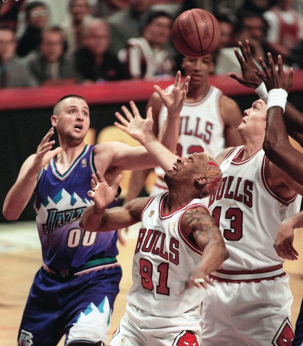 Utah Jazz's Greg Ostertag (00) battles with Chicago Bulls' Dennis Rodman (91) and Luc Longley (13) for a rebound during the first quarter of Game 2 of the NBA Finals Wednesday, June 4, 1997, in Chicago. (AP Photo/Michael Conroy)