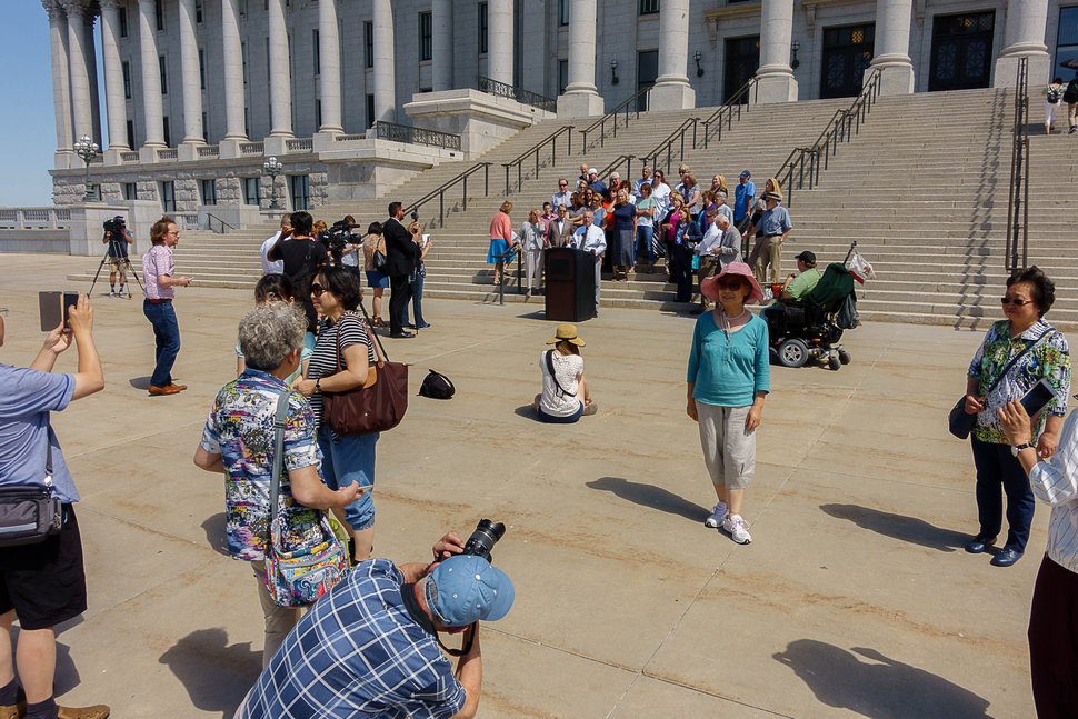 """Trent Nelson   The Salt Lake Tribune Tourists take photographs in front of a news conference in Salt Lake City Tuesday June 27, 2017, announcing the filing of a lawsuit challenging the 2016 law establishing partisan elections for the Utah State Board of Education. Senate Bill 78, """"State Board of Education Candidate Selection,"""" was sponsored by Senator Ann Milner and will go into effect for state school board races starting in 2018."""
