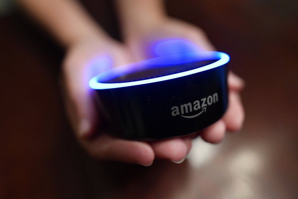 (AP Photo/Mike Stewart) In this Thursday, Aug. 16, 2018, photo a child holds his Amazon Echo Dot in Kennesaw, Ga.