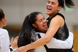(Trent Nelson   The Salt Lake Tribune)  Highland's Kuulei Makaui (2) and Highland's Kaija Glasker (22) celebrate the win as Woods Cross faces Highland in the 5A High School Girls' Basketball Tournament at SLCC in Taylorsville, Wednesday Feb. 21, 2018.