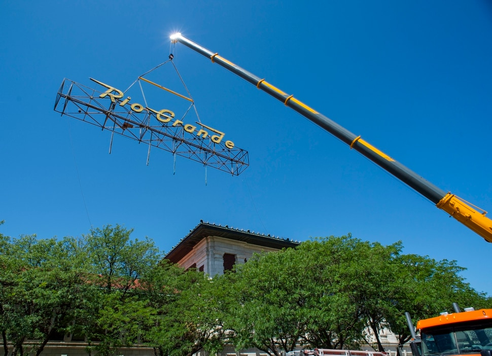 (Rick Egan | The Salt Lake Tribune) The neon Rio Grande sign that has shined from the rooftop of the Rio Grande Depot for more than 50 years is removed from the building, Monday, Aug. 12, 2019.