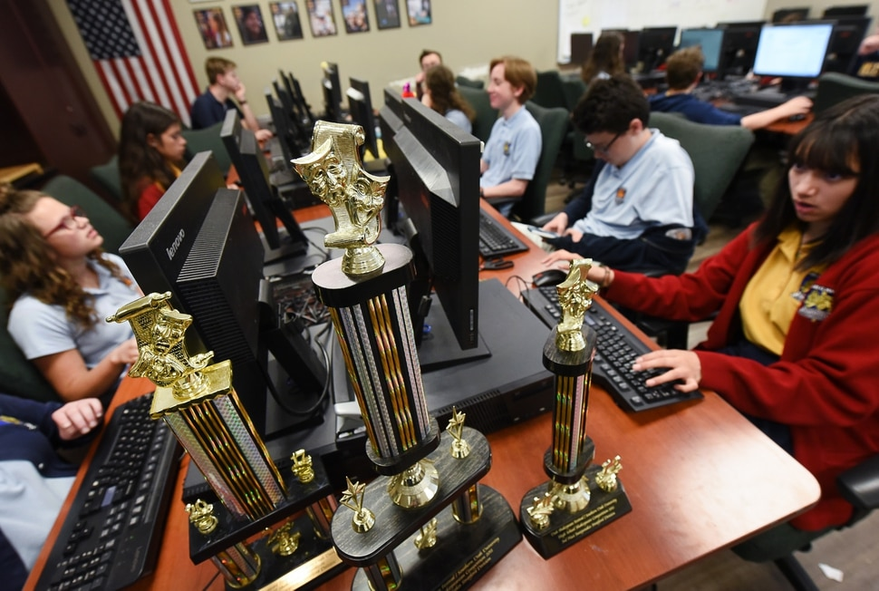(Francisco Kjolseth | The Salt Lake Tribune) Trophies for the high school shakespearean competition are on display in the computer tech room as students work on spreadsheets at the Lindon charter school Karl G. Maeser Preparatory Academy on Tuesday, May 8, 2018. For the second consecutive year the school was named Utah's best high school by U.S. News and World Report.