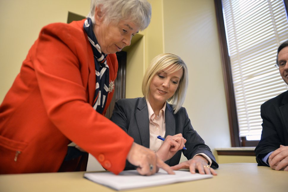 (Chris Samuels | The Salt Lake Tribune) Salt Lake County Councilwoman and gubernatorial candidate Aimee Winder Newton signs a ballot referendum to repeal the recently-passed tax reform bill at a press conference at the Utah State Capitol, Monday, Dec. 23, 2019.
