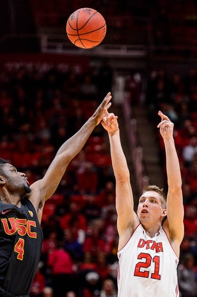 (Trent Nelson | The Salt Lake Tribune) Utah Utes forward Tyler Rawson (21) shoots, with USC Trojans forward Chimezie Metu (4) defending as the University of Utah hosts USC, NCAA basketball at the Huntsman Center in Salt Lake City, Saturday Feb. 24, 2018.