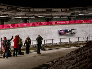 (Hilary Swift   The New York Times) Elana Meyers Taylor, front, and Lauren Gibbs of the U.S. compete in the final heat of the women's bobsled event at the Winter Olympics in Pyeonchang, South Korea, on Wednesday, Feb. 21, 2018. Neuroscientists are trying to understand the dangers that sliding sports, particularly bobsled and skeleton, pose to the brain.