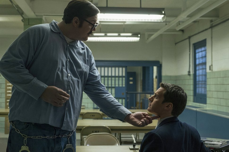 This image released by Netflix shows Cameron Britton, left, and Jonathan Groff in a scene from the 10-episode series