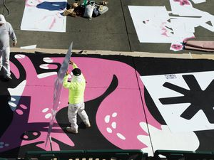 (Rick Egan   The Salt Lake Tribune). Workers paint the crosswalk at the intersection of 100 South and Rio Grande Street, on Wednesday, Nov. 4, 2020.