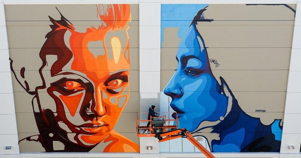 (Francisco Kjolseth | The Salt Lake Tribune) Mural artist Fabio Lopez Gonzalo, aka Dourone, continues work on a large piece on the Clark Planetarium wall entitled