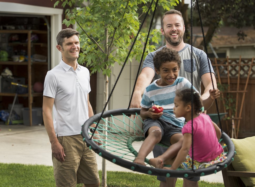 (Leah Hogsten | The Salt Lake Tribune) Brandon Mark and Weston Clark keep their two children, Xander, 6, and Zoe, 3, entertained at their home. Each of the men decided to keep his own last name after the two married in 2013.