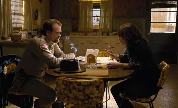This image released by Netflix shows David Harbour, left, and Winona Ryder in a scene from