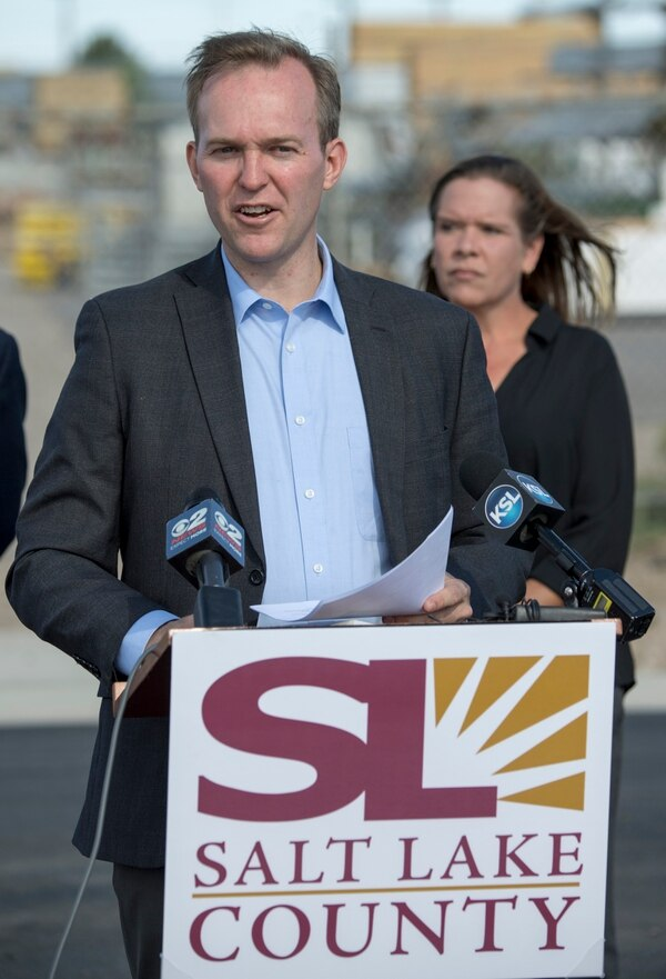 (Rick Egan | The Salt Lake Tribune) Salt Lake County Mayor Ben McAdams speaks at a news conference in the warehouse area of the old Camp Kearns Army Air Force Base, as Salt Lake County celebrates the completion of a $1.9 million project to pave roads and increase business opportunities in the area. Thursday, Aug. 30, 2018.