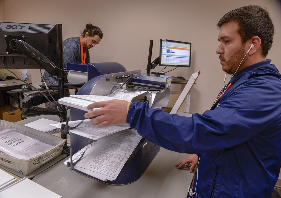 Leah Hogsten | The Salt Lake Tribune Salt Lake County elections official Franco Arellano tabulates votes from ballots, Tuesday, Nov. 13, 2018, at the Salt Lake County building.