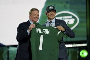 (Steve Luciano | AP) BYU quarterback Zach Wilson, right, poses for a photo with NFL Commissioner Roger Goodell after being drafted by the New York Jets in the first round of the NFL football draft, Thursday, April 29, 2021, in Cleveland.