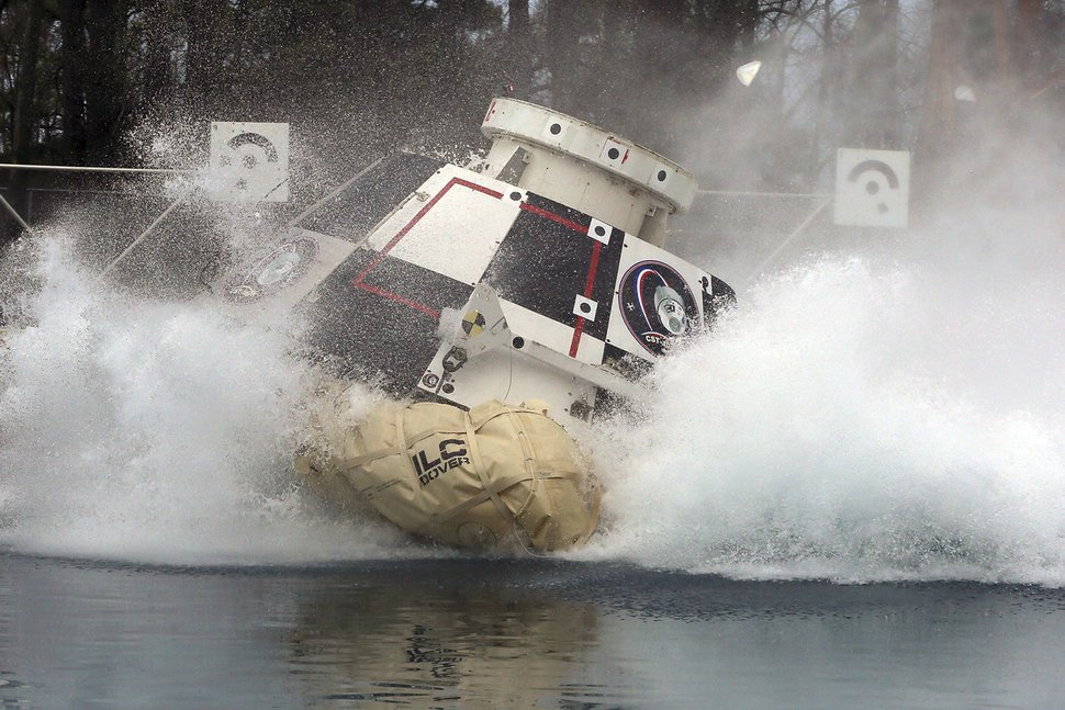 (David C. Bowman/NASA via AP) In this Feb. 9, 2016, photo made available by NASA, a mockup of Boeing's CST-100 Starliner spacecraft, in development in partnership with NASA's Commercial Crew Program, splashes into a 20-foot-deep basin at NASA's Langley Research Center in Hampton, Va., during testing of the spacecraft's landing systems design.
