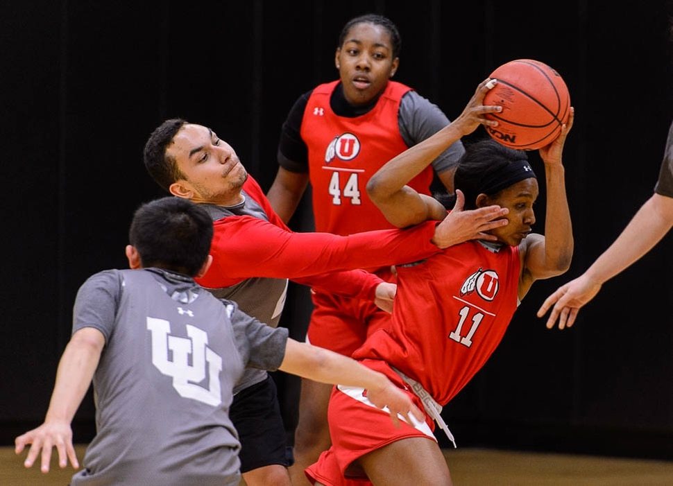 (Trent Nelson | The Salt Lake Tribune) Wyatt Parkin reaches out at University of Utah guard Erika Bean during a practice session on Wednesday Feb. 13, 2019. Male practice players are a key part of the Utah women's basketball program. At right is Dre'Una Edwards.