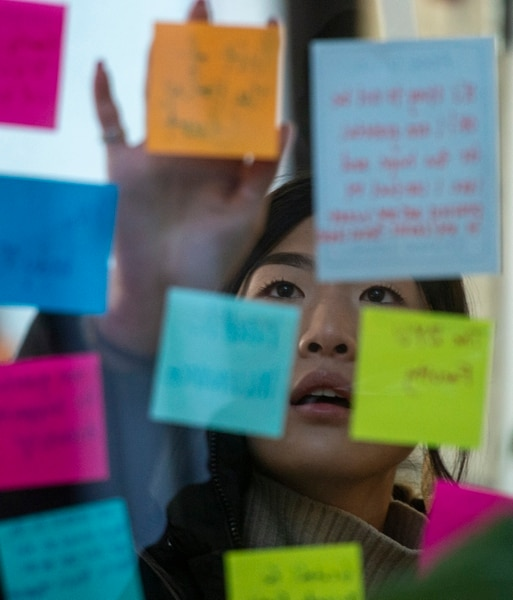 (Rick Egan | The Salt Lake Tribune) Brigham Young University student Valerie Ching posted a note on a window in the Tanner Building Tuesday. Students gathered to write messages of love and support after a student attempted suicide in the building Monday.