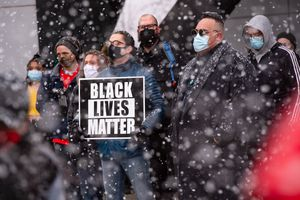 (Francisco Kjolseth  | The Salt Lake Tribune) Snow falls during a rally at the Federal Building in Salt Lake City on Martin Luther King Jr. Day, Monday, Jan. 18, 2021.