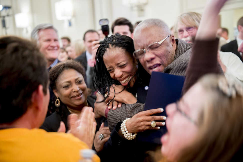Jeremy Harmon | The Salt Lake Tribune Mia Love gets a hug from her father after she beat opponent Doug Owens in the race for Utah's 4th Congressional District, Tuesday November 4, 2014.