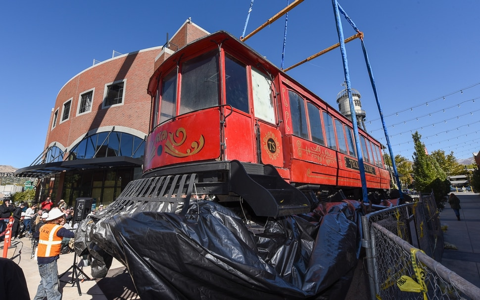 (Francisco Kjolseth | Francisco Kjolseth) The iconic trolley car, that has been sitting in storage for several years, is moved back into view at Trolley Square on Monday, Oct. 15, 2018 as people gather for the repositioning ceremony. The empty trolley car, last seen housing the Trolley Wing Company was moved into place on the north plaza by Pottery Barn.