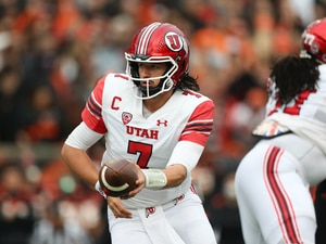 (AP Photo/Amanda Loman) Utah quarterback Cameron Rising (7) hands the ball off during the first half of the team's NCAA college football game against Oregon State on Saturday, Oct. 23, 2021, in Corvallis, Ore.