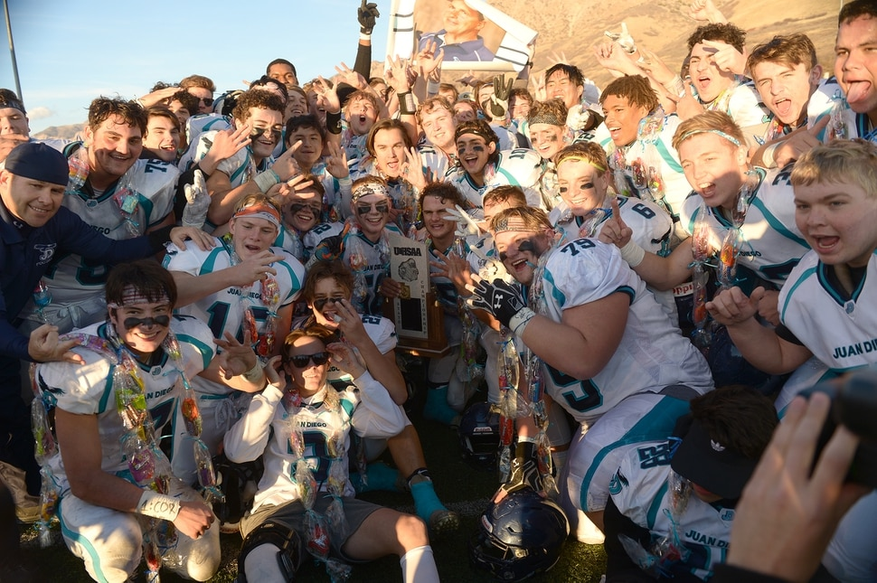 (Leah Hogsten | The Salt Lake Tribune) Juan Diego players hold three fingers up, representing the third straight 3A state title in a row. Juan Diego High School boys' football defeated Morgan High School 45-20 to win the 3A State Championship game Saturday, Nov. 11, 2017 at Weber State University's Stewart Stadium in Ogden.