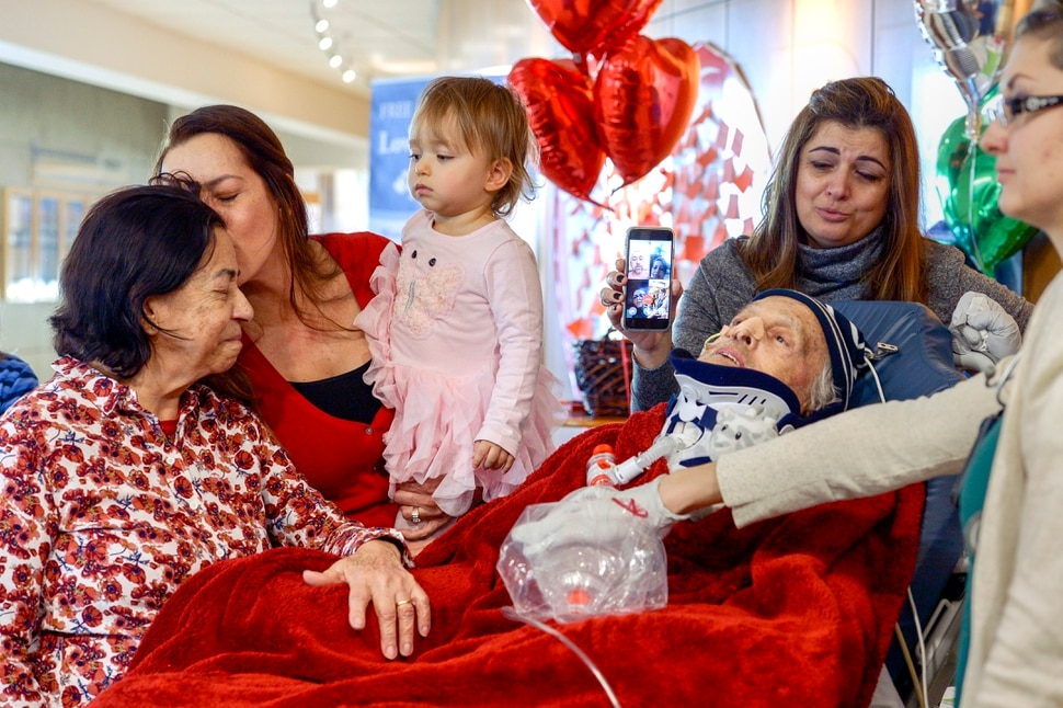 Leah Hogsten | The Salt Lake Tribune l-r Lucia Silva, daughter Flavia Beare, granddaugher Petra Beare, and family friend Cristina Tesolin weep as they tend to their husband and father, Osvaldo Silva. On Friday, Intermountain Hospital caregivers wheeled paralyzed cancer patient Osvaldo Silva, 85, down to the lobby for a personal piano concert in his honor, Feb. 15, 2019. With tears streaming down his face, Osvaldo, who is from Brazil, was treated to a dozen songs played by his Church of Jesus Christ of Latter-day Saints bishop, Bispo Do Pai Valdir, who kicked off the set with none other than ÒThe Girl from Ipanema.Ó
