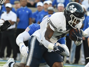Utah State running back Calvin Tyler runs with the ball in the second quarter of an NCAA college football game against Air Force at Air Force Academy, Colo., Saturday, Sept. 18, 2021. (Jerilee Bennett/The Gazette via AP)