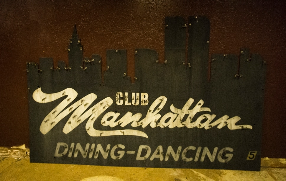 (Rick Egan | The Salt Lake Tribune) The original Manhattan Club sign will be used in the new Quarters Arcade Bar when it is remodeled, Monday, November 20, 2017.