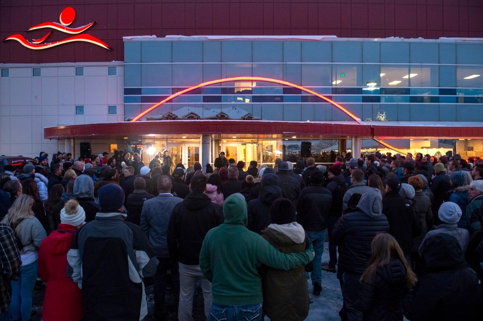 (Rick Egan | The Salt Lake Tribune) Friends and loved ones of David Stokoe gather for a candlelight vigil at the RanLife Home Loans building where he worked in Sandy, Monday, Jan. 21, 2019.