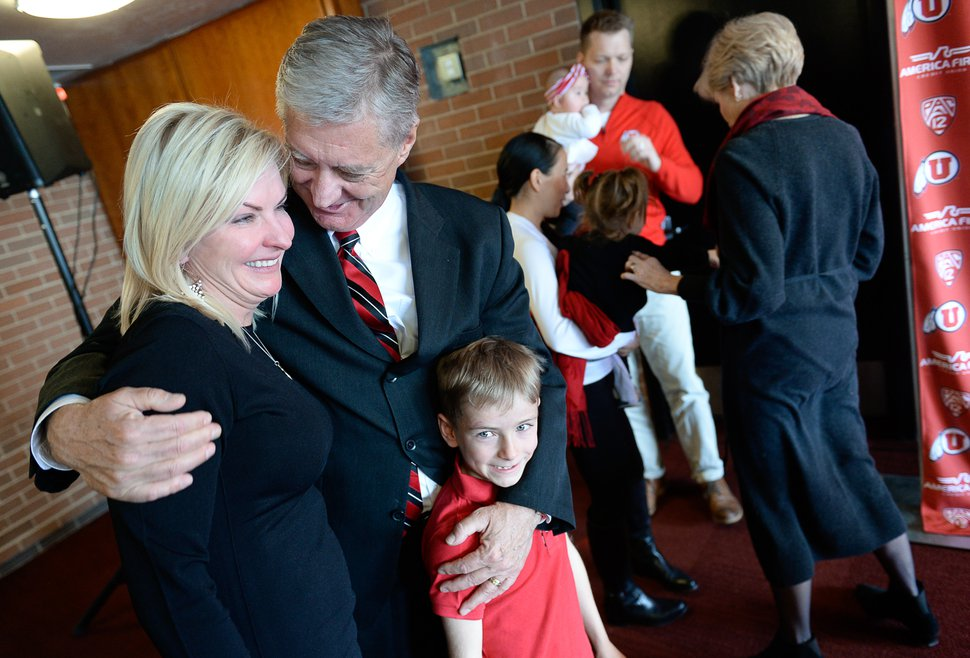 (Francisco Kjolseth | The Salt Lake Tribune) University of Utah Athletic Director Chris Hill embraces his daughter Aly Hill and her son Jack Forsyth, 7, after announcing his plan to retire this spring after 31years. Joined by his wife, Kathy, and their kids and grandkids at the Jon M. Huntsman Center on campus on Monday, March 26, 2018, Hill is the longest actively tenured athletic director at the same school in the NCAA FBS.