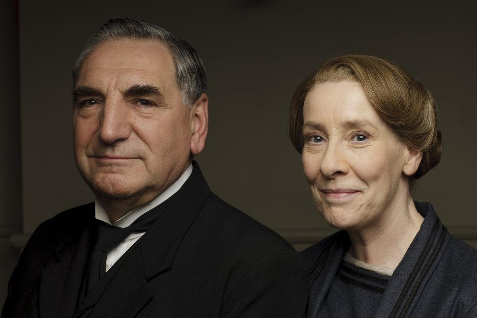 | Courtesy of Nick Briggs/Carnival Film & Television Limited 2015 for Masterpiece Jim Carter as Mr. Carson and Phyllis Logan as Mrs. Hughes in ÒDownton Abbey.Ó