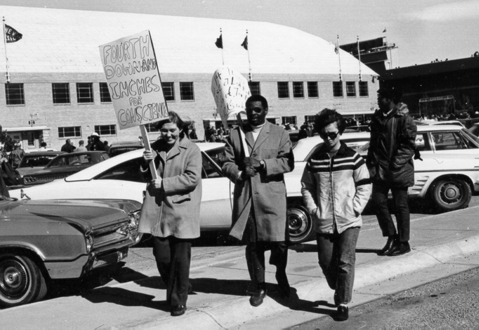 (photo courtesy the University of Wyoming) Kathy Karpan, left, who later went on to run for Governor in Wyoming, protests with unknown others during the Black 14 incident in Wyoming. photo courtesy the University of Wyoming