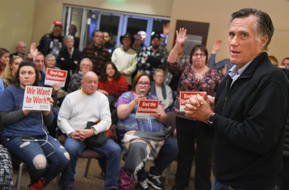 (Francisco Kjolseth | The Salt Lake Tribune) U.S. Senator Mitt Romney visits some of the overflow rooms where people expressed their anger over the federal shutdown after holding a town hall meeting at the Davis County administration building, Tuesday, January 22, 2019, to hear from local residents.