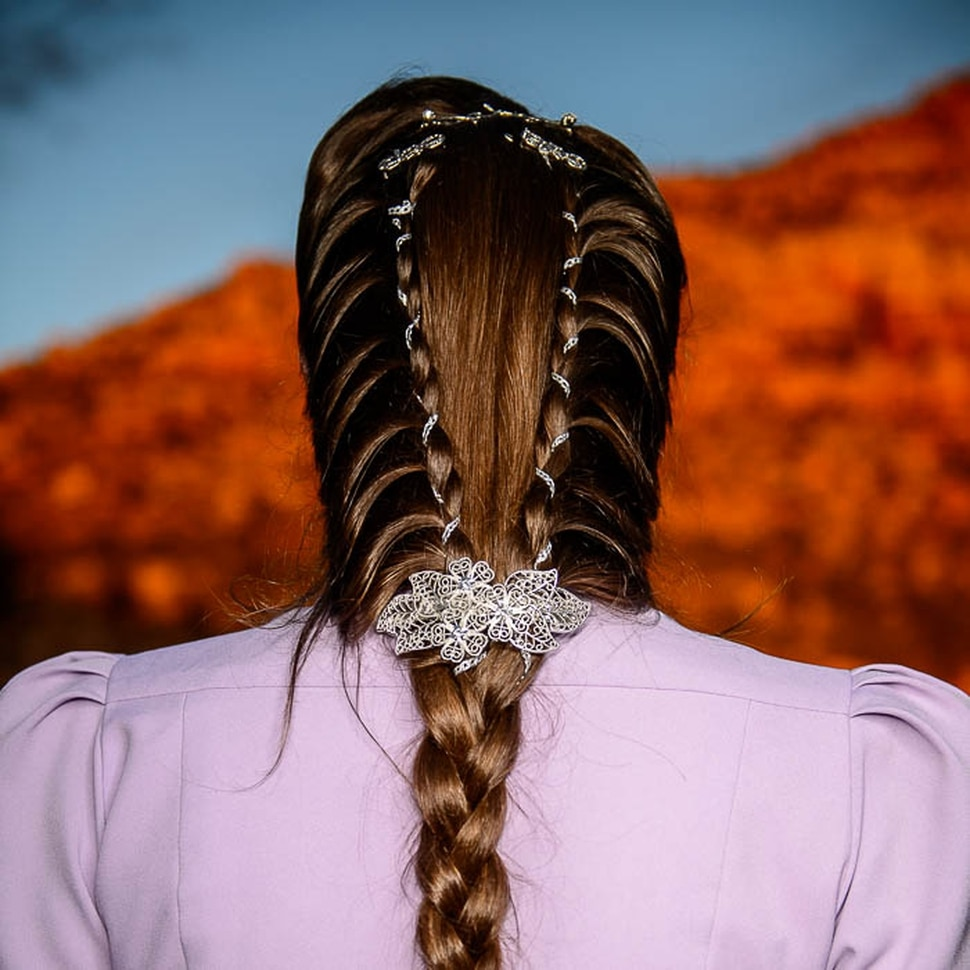 (Trent Nelson | The Salt Lake Tribune) A princess party was thrown for several young FLDS girls in Colorado City, Ariz., Friday March 16, 2018, as a reward for reading books. Before the party, Angela Bistline showed her braids.