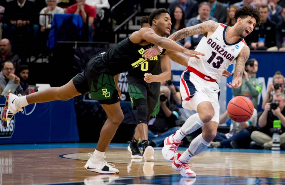 (Leah Hogsten | The Salt Lake Tribune) Gonzaga Bulldogs guard Josh Perkins (13) is fouled by Baylor Bears guard Jared Butler (12) as Baylor faces Gonzaga in the second round of the NCAA tournament in Salt Lake City on Saturday, March 23, 2019.