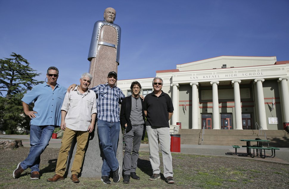 In this Friday, April 13, 2018, photo, the Waldos, from left, Mark Gravitch, Larry Schwartz, Dave Reddix, Steve Capper and Jeffrey Noel pose below a statue of Louis Pasteur at San Rafael High School in San Rafael, Calif. Friday is April 20, or 4/20. That's the numerical code for marijuana's high holiday, a celebration and homage to pot's enduring and universal slang for smoking. And the five Northern California high school stoner buddies widely credited with creating the shorthand slang for getting high nearly 50 years ago now serve as the day's unofficial grand masters. (AP Photo/Eric Risberg)