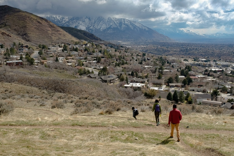 (Francisco Kjolseth | The Salt Lake Tribune) As the coronavirus grips the nation, people are taking to the trails in search of a therapeutic safe space. People get outdoors along Jacks Peak Trailhead above the Salt Lake Valley on Friday, March 20, 2020.