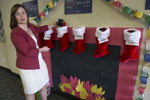 """(Scott Sommerdorf      The Salt Lake Tribune)    U.S. Senate candidate Jenny Wilson, a Salt Lake County councilwoman, demonstrates the uncertainty Utahns face after the passage of the new tax plan by Congress by saying there is """"coal"""" in the Christmas stockings of families, workers and children after a press conference, Thursday, December 21, 2017."""