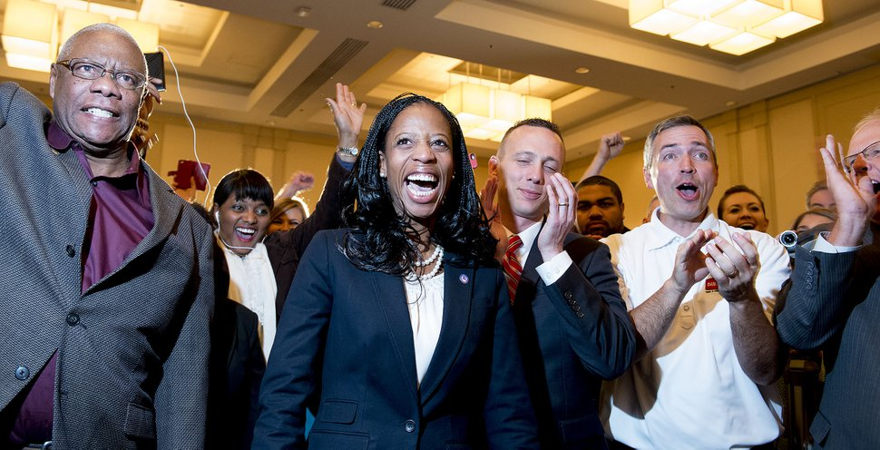 Steve Griffin | The Salt Lake Tribune Mia Love celebrates with family and supporters after defeating opponent Doug Owens in the race for Utah's 4th Congressional District, Tuesday November 4, 2014.