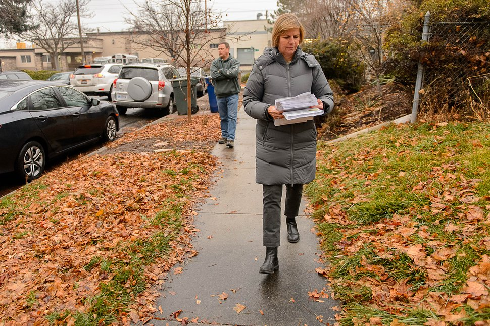 (Trent Nelson | Tribune file photo) Salt Lake City Councilwoman Lisa Adams goes door-to-door in the area around 653 E. Simpson Avenue — a neighborhood once designated to be the site of one of several planned homeless resource centers. The Simpson Ave. site was later removed. December 14, 2016. She was accompanied by Detective Keith Peterson after receiving threatening emails.