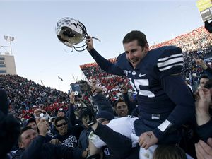Provo - BYU fans hold Brigham Young quarterback Max Hall (15) on their shoulders, celebrating victory as BYU defeats the University of Utah 17-10 in college football action Saturday at BYU's Lavell Edward Stadium.Trent Nelson/The Salt Lake Tribune; 11.24.2007