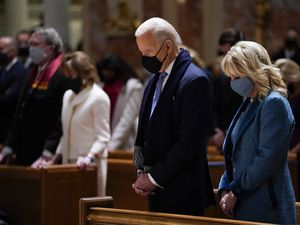 (Evan Vucci | AP)  President-elect Joe Biden and his wife Jill Biden as they attend Mass at the Cathedral of St. Matthew the Apostle during Inauguration Day ceremonies Wednesday, Jan. 20, 2021, in Washington.