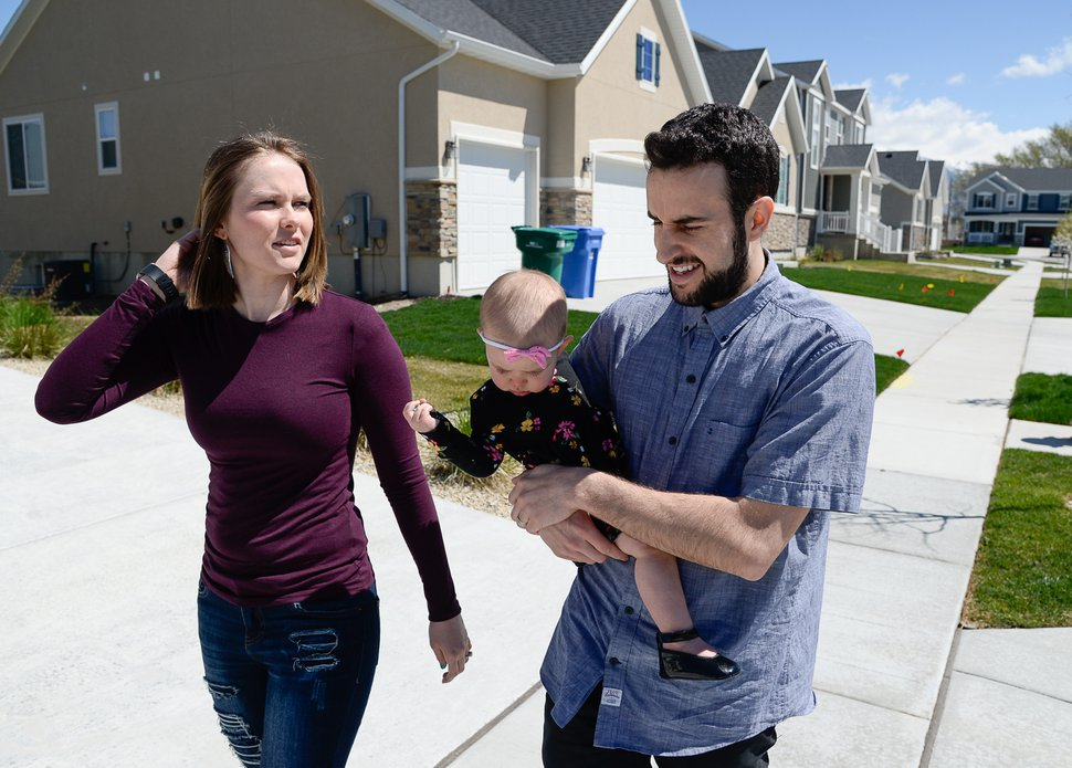(Francisco Kjolseth | Tribune file photo) Ember and Jeremy Ulrich take their daughter Jemma, 1, for a walk around their newly developed neighborhood in Lehi earlier this year. Along with some friends who were also looking to get more house for their money and ended up moving in next door, Jeremy wanted to be closer to his job at Adobe in Lehi.