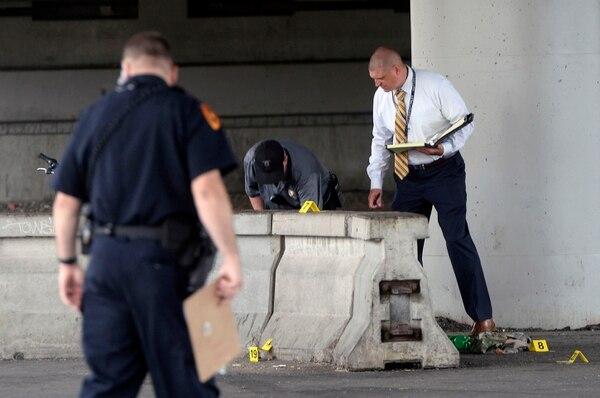 Al Hartmann   The Salt Lake Tribune Salt Lake City police investigate homicide-assault crime scene near 500 S. 500 W. Tuesday July 25.