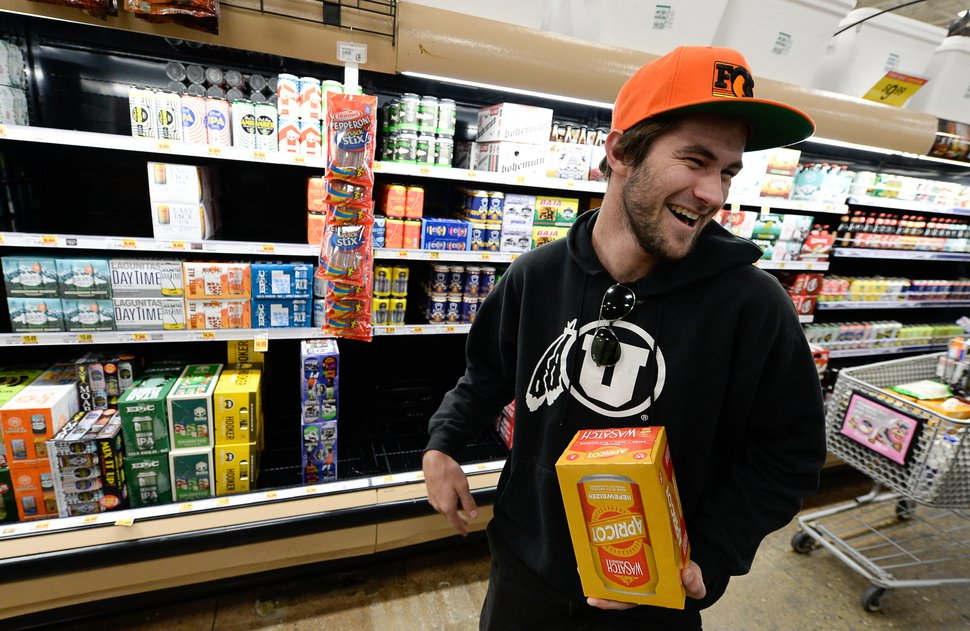 (Francisco Kjolseth | The Salt Lake Tribune) Andy Shafer picks out a fresh pack of Wasatch beer as he visits the beer isle at Smith's Marketplace in Bountiful filled with the new beer that is 5% alcohol by volume on Friday, Nov. 1, 2019, for the first time in 86 years.