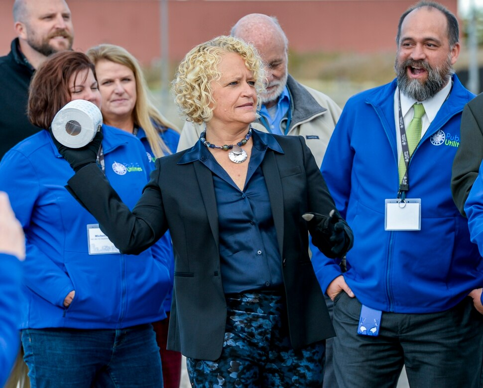 (Leah Hogsten | The Salt Lake Tribune) Salt Lake City mayor Jackie Biskupski feigns throwing a roll of toilet paper at the director of the department of public works during a ground breaking for the new construction of a Water Reclamation FacilityÑthe largest non-airport public works facility in Salt Lake City history, Oct. 22, 2019. The $528-million wastewater treatment project will take six years to complete.