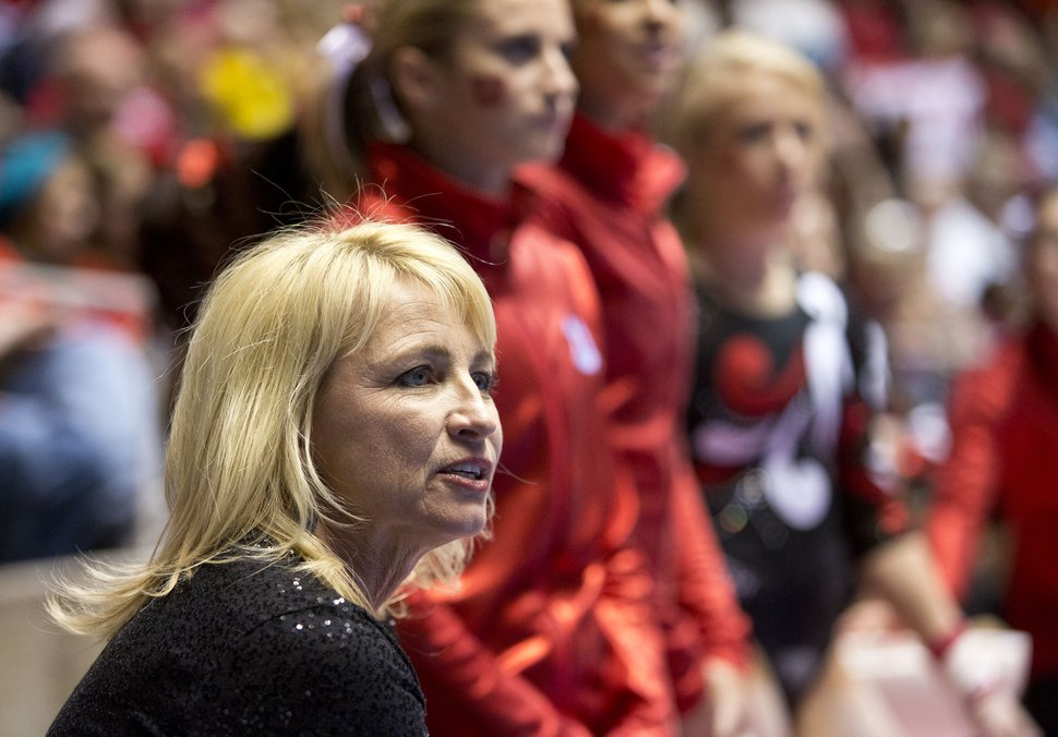 Lennie Mahler | The Salt Lake Tribune Co-head coach Megan Marsden observes the Red Rocks as they warm up on the uneven bars in a meet against Oregon State, West Virginia, and SUU at the Huntsman Center, Saturday, Jan. 19, 2013. The Red Rocks edged the competition with a final score of 196.950, followed by Oregon State with a score of 195.950.